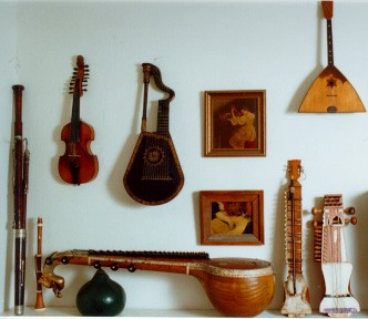 Picture of bassoon, boxwood flute, dital harp, balalaika, South Indian vina (Saraswati vina), dilruba and sarangi.