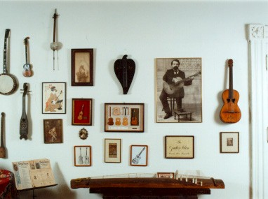 Picture of English banjo, Balkan tamboritza, Javanese spike fiddle, primitive Alaskan instrument, Balinese fiddle, heart shaped bowed zither (played on a flat table), Tarrega picture, Portugese guitar (rosette of 2 hearts), and koto.